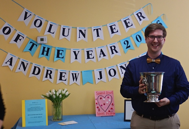 Andrew Jones holding the Annie F. Oliver Award for Volunteer of the Year.
